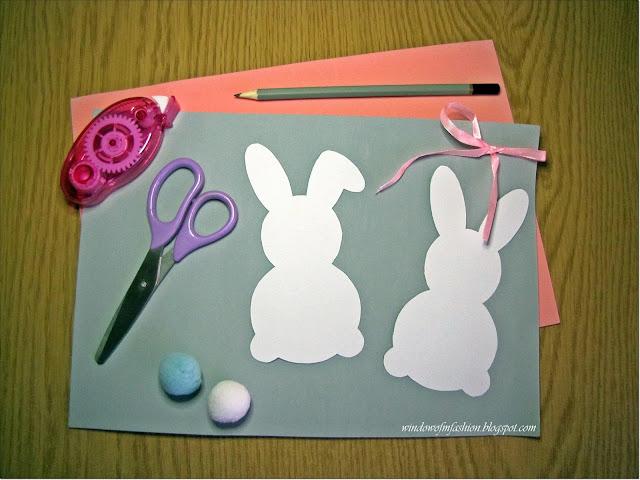 Arkusz pianki/ kolorowe kartki, ołówek, nożyczki, pomponiki, klek w taśmie, wstążeczka, szablony zajączków