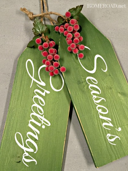 Green wooden Season's Greeting tags with red berries
