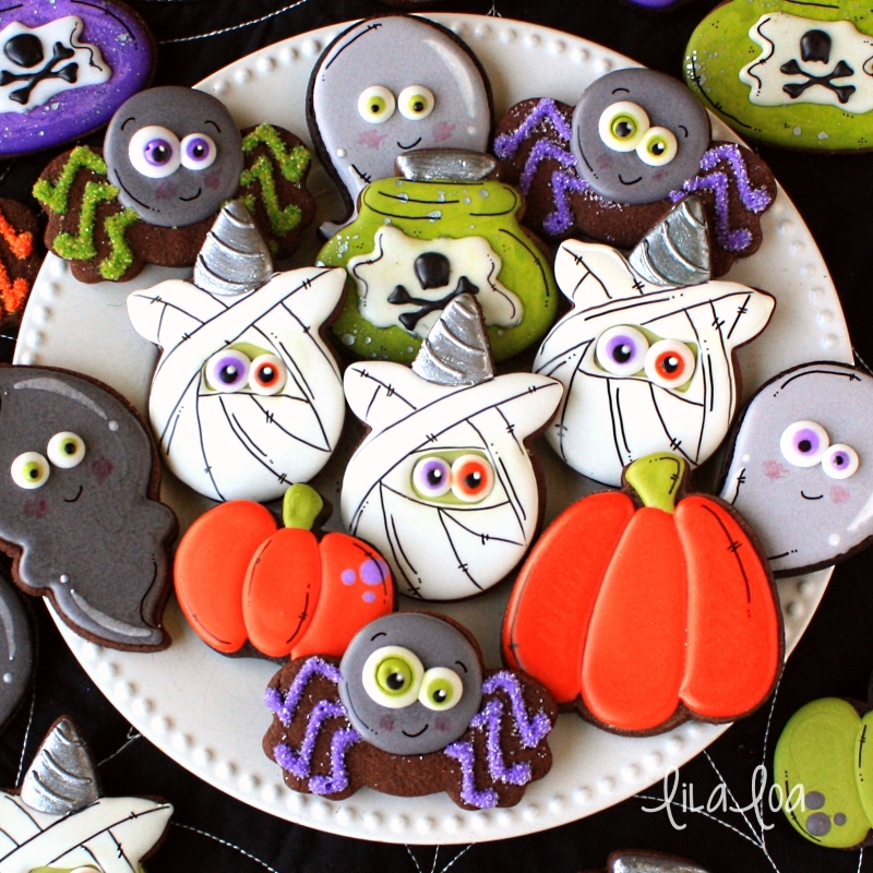 Decorated Halloween sugar cookies - unicorn mummies, potion bottles, spiders, pumpkins and ghosts