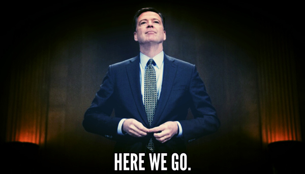 image of James Comey standing in a Congressional hearing room, buttoning his jacket, with his chin lifted rather haughtily, to which I've added text reading: 'Here we go.'
