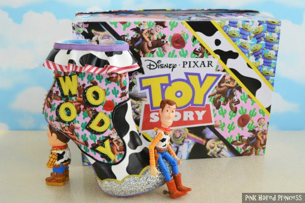 Woody toy figure sitting on Woody ankle boot with Irregular Choice shoe box in background