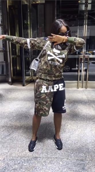 Tiwa Savage dabs in military camouflage