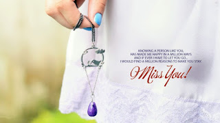 beautiful pic of girl hand holding earing with miss you quote