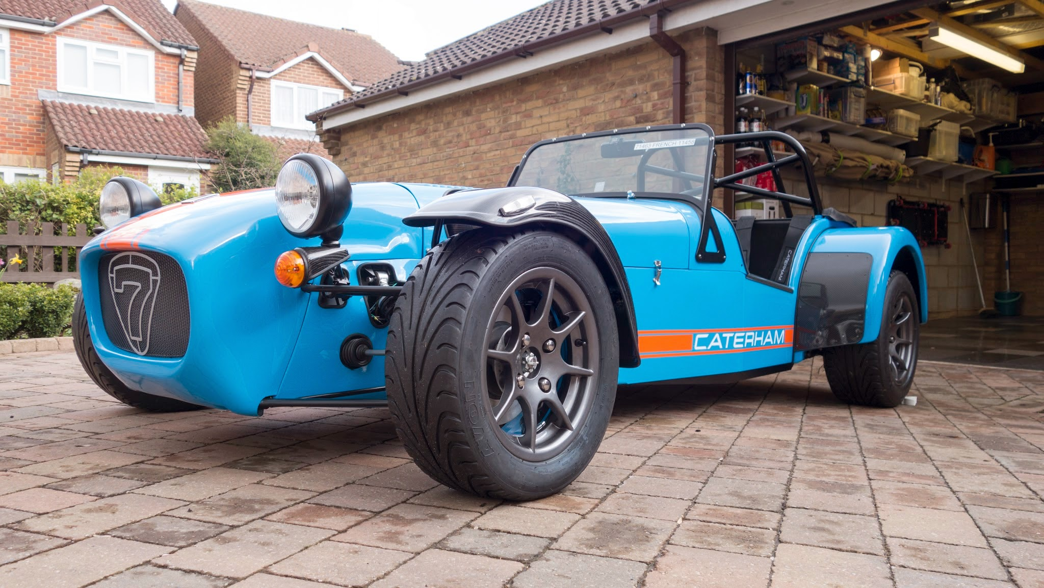 Caterham R500 with anthracite wheels painted in Porsche Riviera Blue 39e with Mactac Semi Fluorescent Orange and white Caterham Font triple stripe and decals.