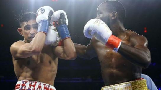 Crawford wins by TKO when Khan can't continue