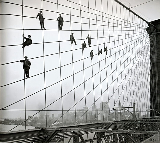 painters on the cables of the brooklyn bridge october 7 1914