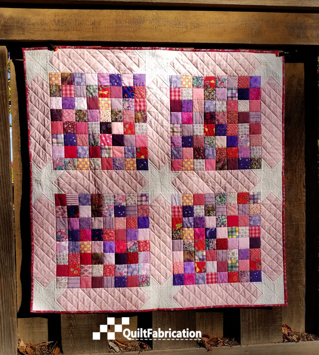 Scrap Happy baby quilt from the Charm School book