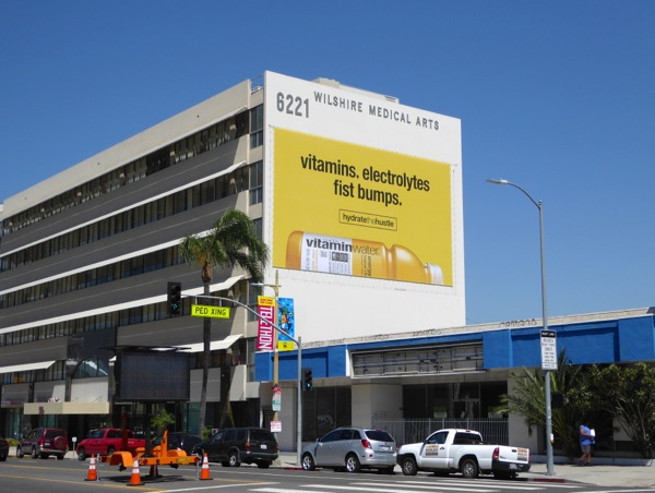 Vitamin Water Hydrate the Hustle fist bumps billboard