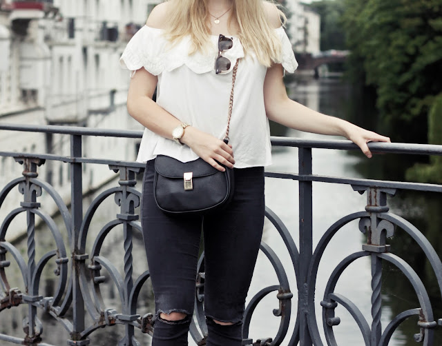 how-to-style-white-off-shoulder-top-black-denim-hamburg-outfit
