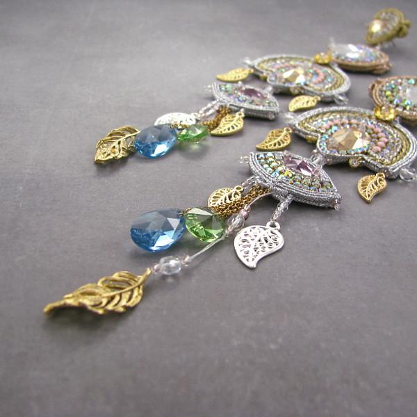 Kunsztowne, luksusowe, złote kolczyki Swarovski Elements.