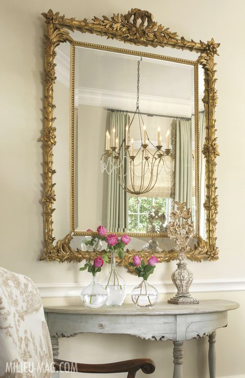 Swedish antique table and mirror in Milieu magazine