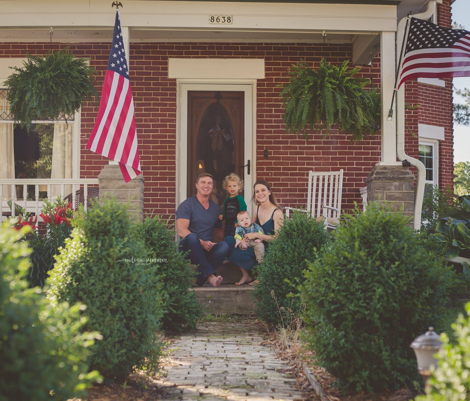 The Author's Family on their front steps of their old brick home