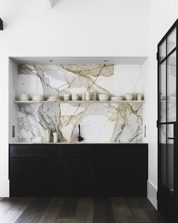 Impressive marble backsplash in the kitchen designed by Handelsmann and Khaw