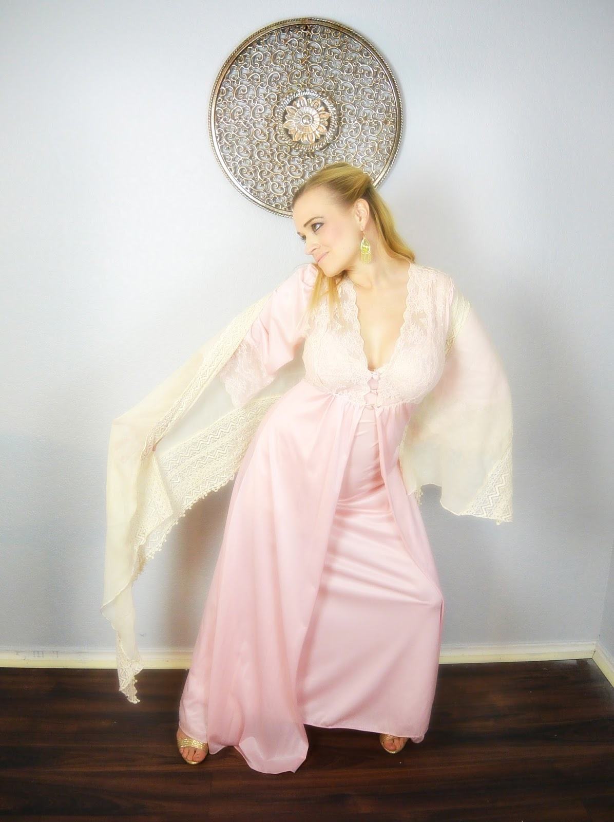 blonde modeling vintage pink lace nightgown and scarf with wall art
