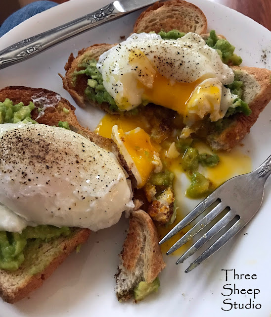 Avocado over toast with Poached Eggs.  Yum !