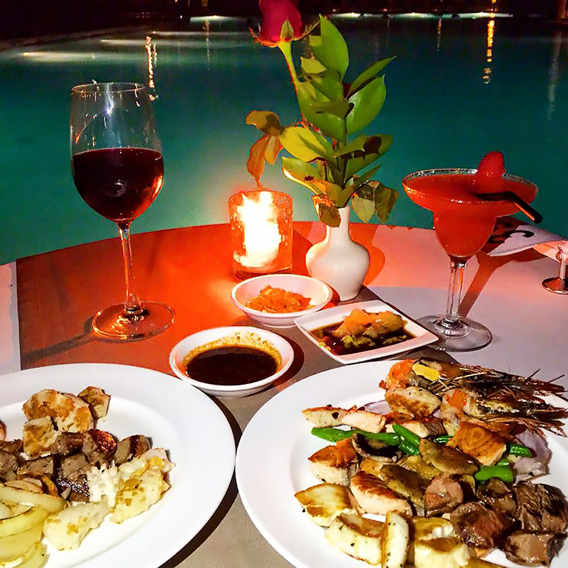 Dinner by the pool at Padma Resort Legian