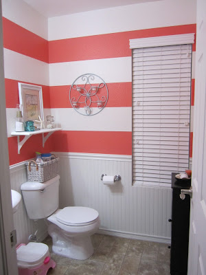 Just another day in paradise coral striped bathroom for Bright coloured bathroom accessories