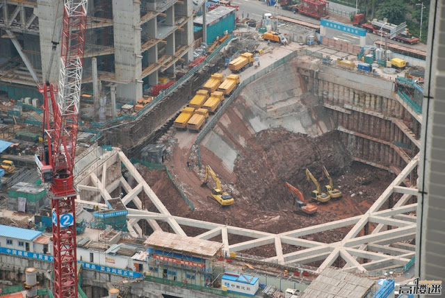 Photo of really deep construction hole right next to The Chow Tai Fook Skyscraper Construction Site, Guangzhou, China