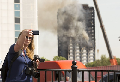 It's a disgrace that people are taking selfies at the site of the deadly London fire - Residents lament