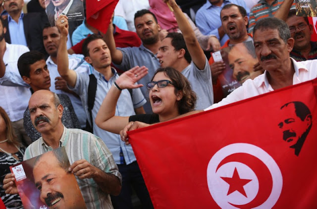Image Attribute: Supporters of the opposition Popular Front Party take part in an anti-austerity  demonstration in Tunis,Tunisia October 15, 2016. REUTERS/Zoubeir Souissi