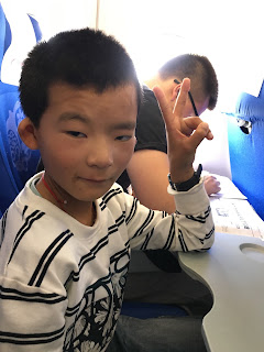 Chinese boy on airplane