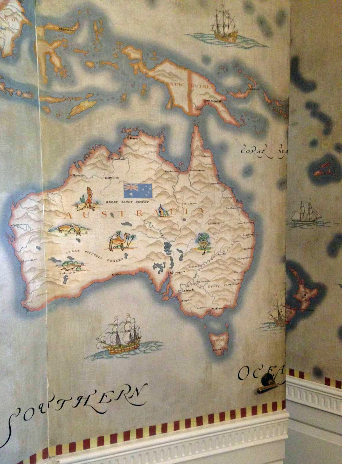 a secret door leads to a spiral staircase and in the former children s bedroom all walls are covered with a 1927 world map with pictures of wild