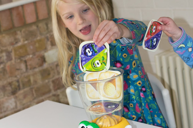 A child putting a apple and blackberry card into the Little Tikes Crazy Blender