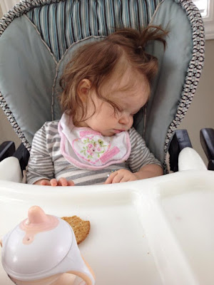 baby sleeping in high chair