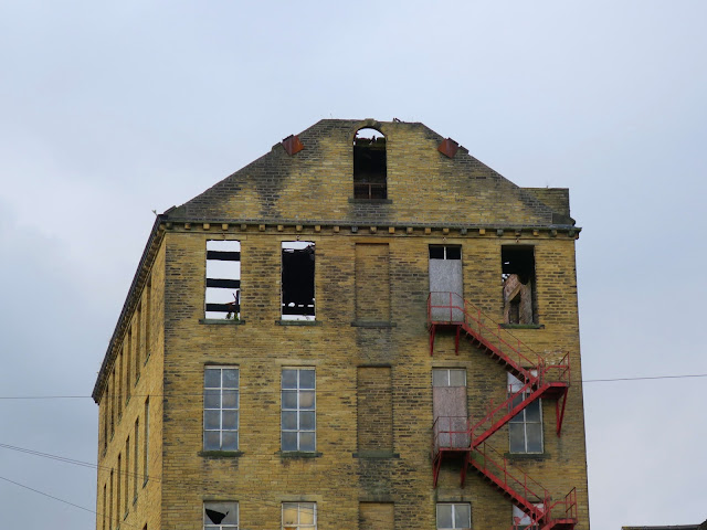 Derelict mill with red staircase