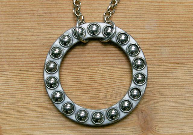 https://www.etsy.com/listing/570245466/cyberpunk-bearing-statement-pendant