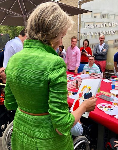 Queen Mathilde of Belgium visited a camp in Ter Helme. Queen Mathilde wore Natan combination during two visits in Oostduinkerke