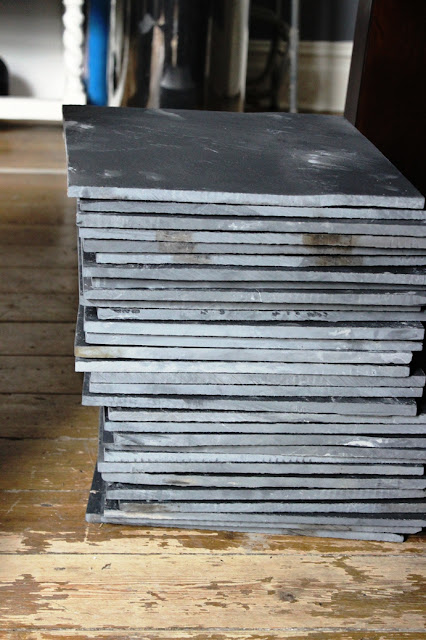 sorting the slate tiles in order of thickness