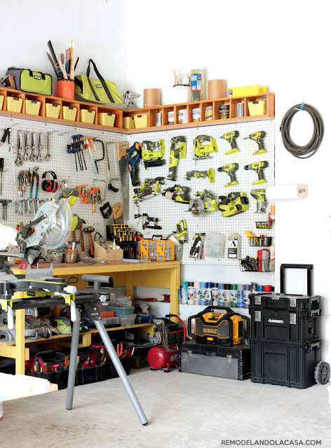 garage workshop with pegboard tool organization and miter saw and Ryobi power tools