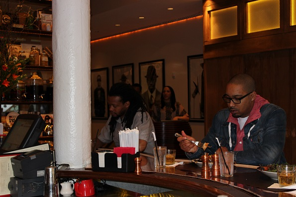 Man at Red Rooster bar New York