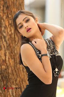 Actress Poojitha Pallavi Naidu Stills in Black Short Dress at Inkenti Nuvve Cheppu Movie Platinum Disc Function  0144.JPG