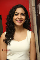 Actress Ritu Varma Stills in White Floral Short Dress at Kesava Movie Success Meet .COM 0131.JPG