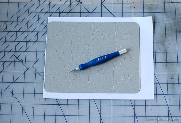 Cutting pieces to make a personalized puzzle