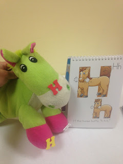 Stuffed animal teaching letter H