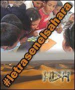 Banner de campaña Letras en el Sahara. Desierto y niños con libros, con el hastag de la iniciativa escrito en diagonal sobre la imagen