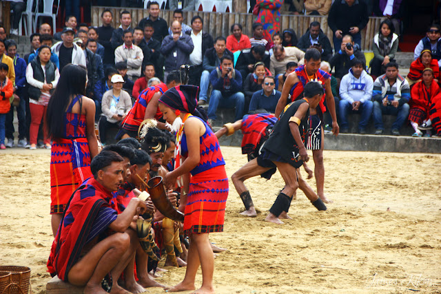 Chang Nagas playing games in traditional costumes at Nagaland Hornbill Festival 2015