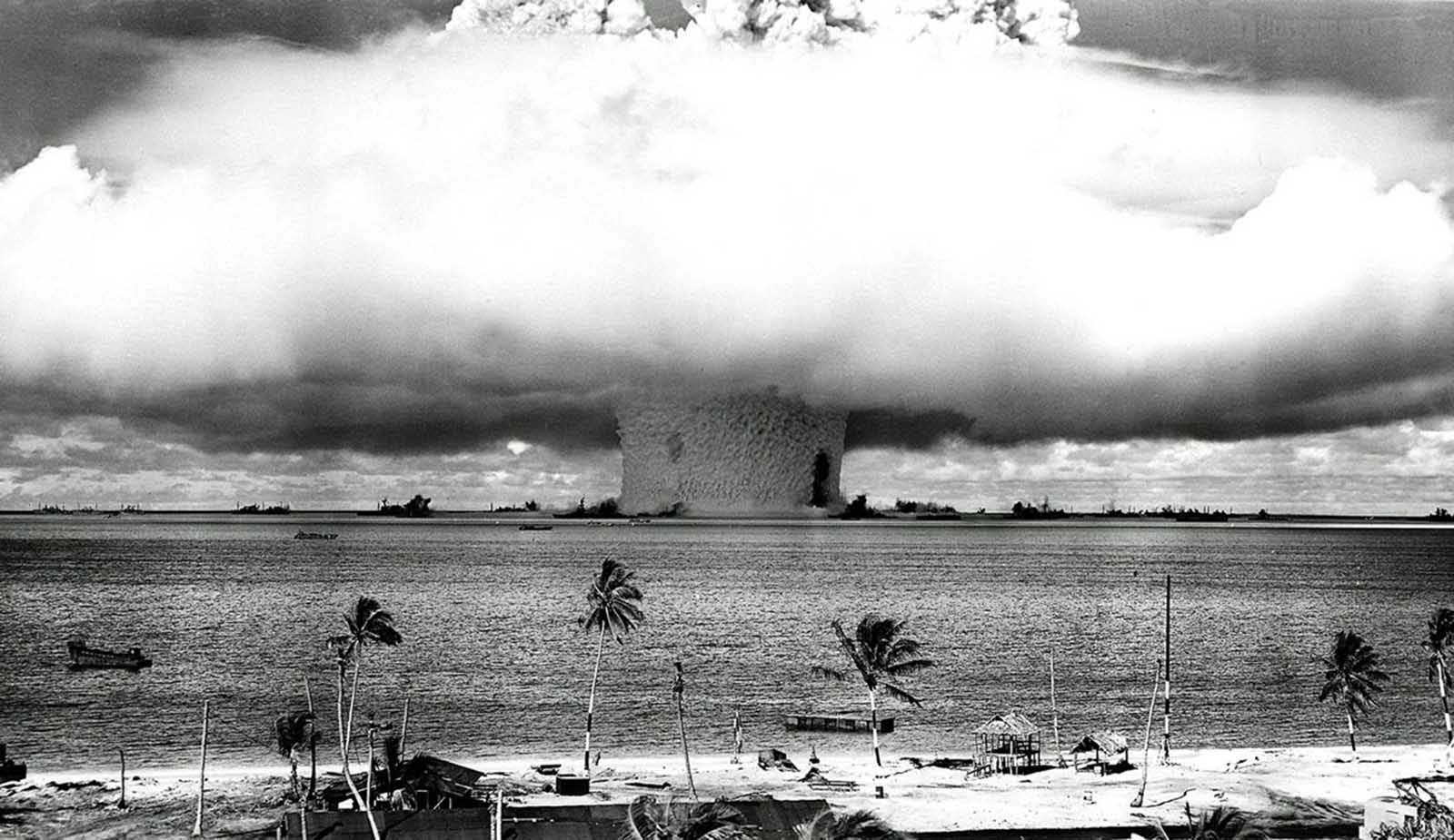 A massive column of water rises from the sea as the U.S. detonates an atomic bomb at Bikini Atoll in the Pacific in the first underwater test of the device, on July 25, 1946. The blast and the enormous wave of water that followed immediately overwhelmed several abandoned ships, which were part of the site's dummy fleet of former warships.