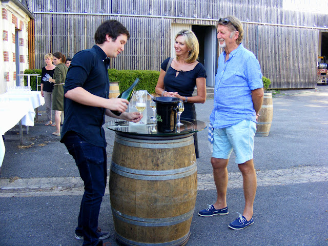 Tasting a new wine at Chateau Gaudrelle, Vouvray AOC.  Indre et Loire, France. Photographed by Susan Walter. Tour the Loire Valley with a classic car and a private guide.