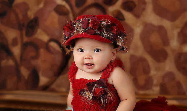 lovely baby girl in red dressing