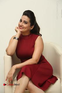 Telugu Tollywood Anchor Manjusha Pos in Red Short Dress  0044.JPG