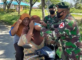 Satgas Yonarmed 9 Laksanakan Penertiban Penggunaan Masker di Desa Sangaji