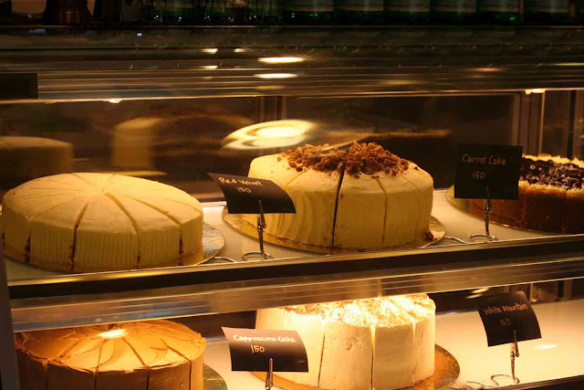 cakes inside refrigerated glass display