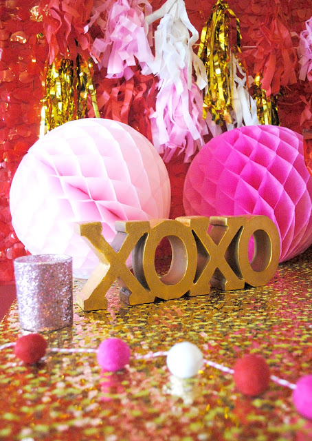 Galentine's Day Party theme of XOXO with colors of pink, gold and red. See the whole party at www.fizzyparty.com