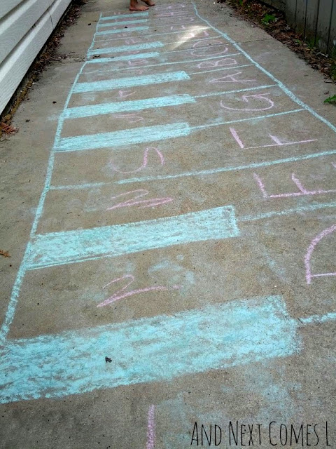 Close up of numbers and letters on a giant chalk piano keyboard drawing