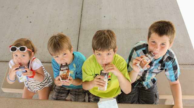 kids drinking their shelf stable milk at the park