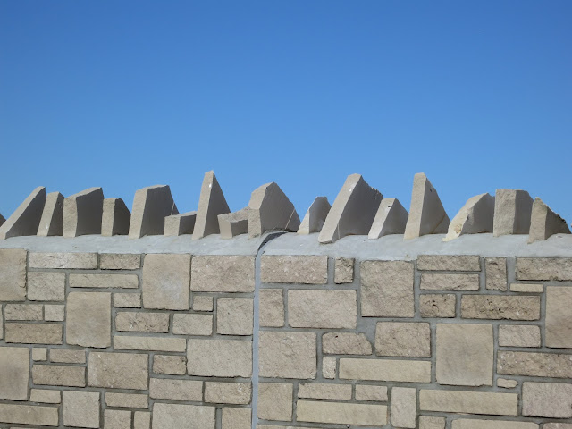 Concrete and stone wall and blue sky